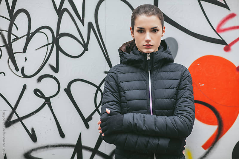 Woman Posing in a Black Winter Jacket by Mosuno for Stocksy United