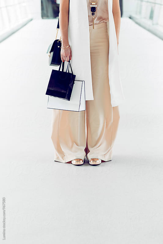 Woman Carrying Shopping Bags in the Shopping Mall by Lumina for Stocksy United