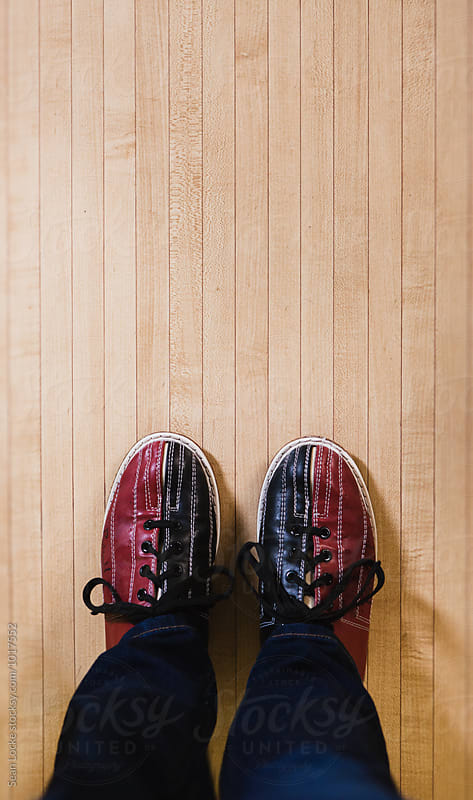Bowling: Looking Down At Pair Of Rental Shoes by Sean Locke for Stocksy United