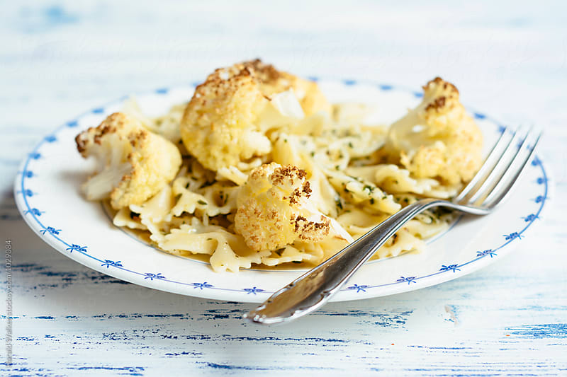 Bow Tie Pasta with Roasted Cauliflower and Herbs by Harald Walker for Stocksy United