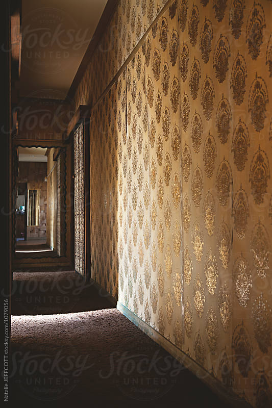 Funky old wallpaper in hallway of old house by Natalie JEFFCOTT for Stocksy United