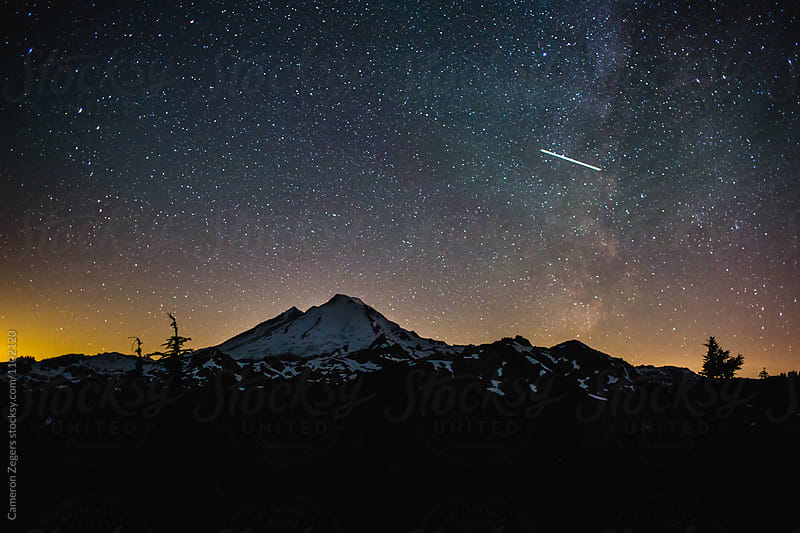 starry sky over Mount Baker, Washington by Cameron Zegers for Stocksy United