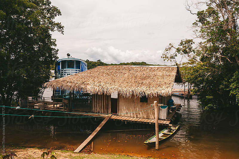 River hut on Rio Juma by Gabriel Tichy for Stocksy United