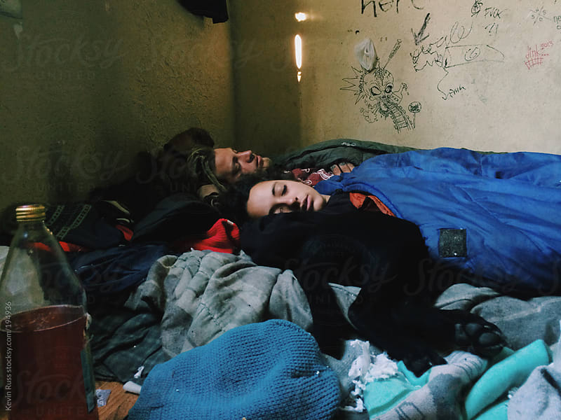 Couple Sleeping in Abandoned House by Kevin Russ for Stocksy United