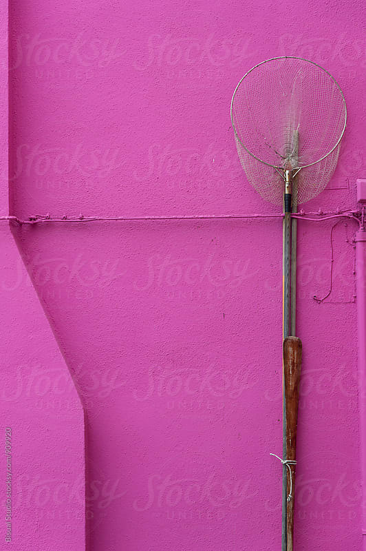 Fishing net on a pink wall in Burano, Italy by Bisual Studio for Stocksy United