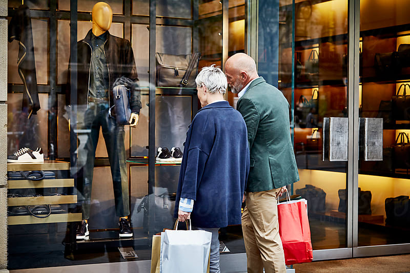 Senior Couple Window Shopping In City by ALTO IMAGES for Stocksy United
