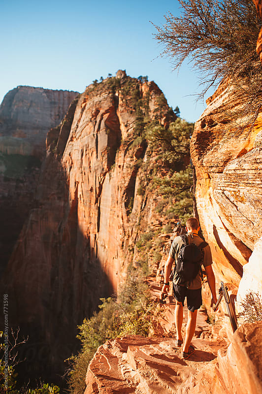 Man Hiking Angels Landing in Zion National Park by michelle edmonds for Stocksy United