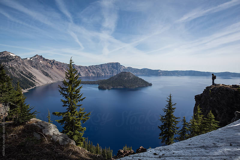 Man standing in front of the beautiful landscape of Crater Lake by michela ravasio for Stocksy United
