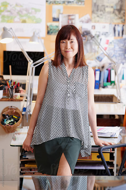 Portrait of Japanese businesswoman leader at the office by Aila Images for Stocksy United