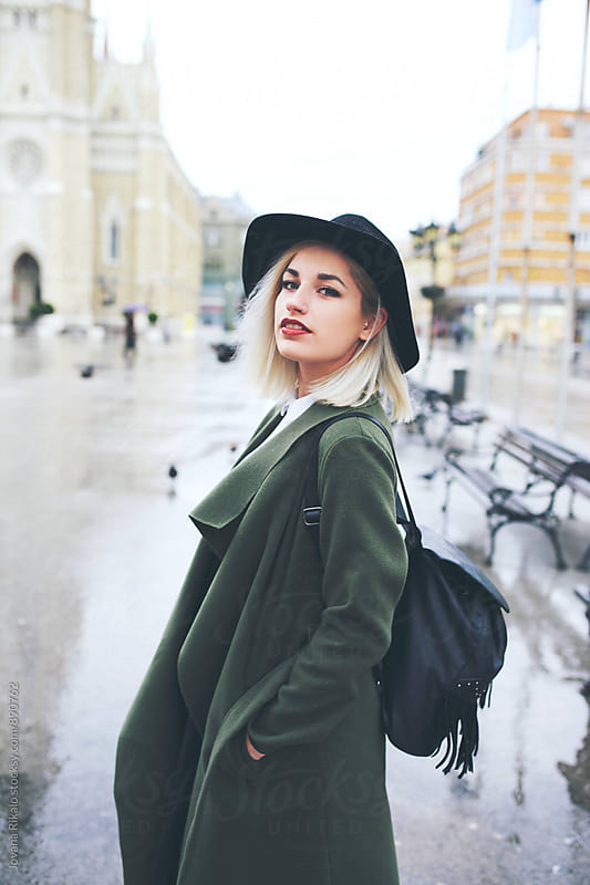 Stylish young woman on street by Jovana Rikalo for Stocksy United