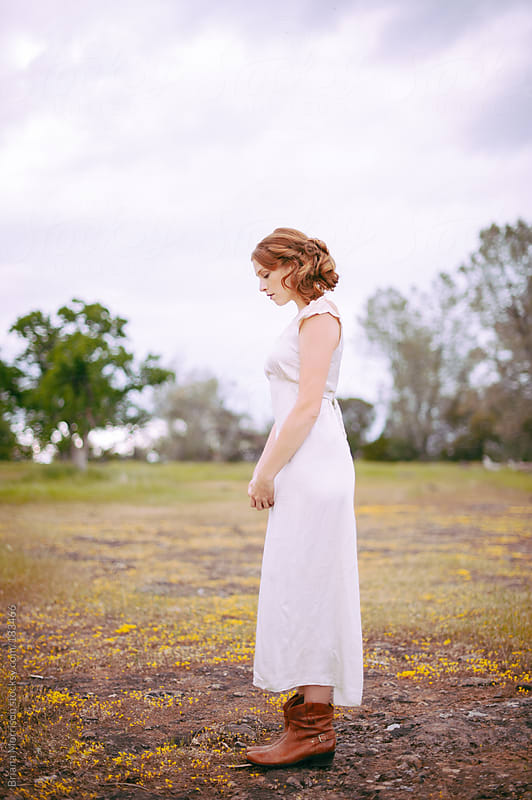 Woman with Red Hair Wearing Vintage White Dress in Country by Briana Morrison for Stocksy United