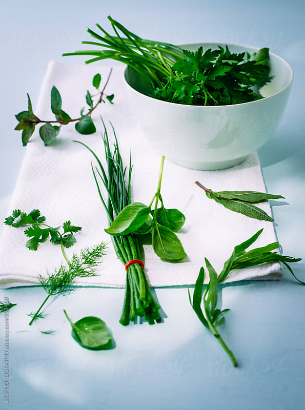 Bowl with fresh herbs by J.R. PHOTOGRAPHY for Stocksy United