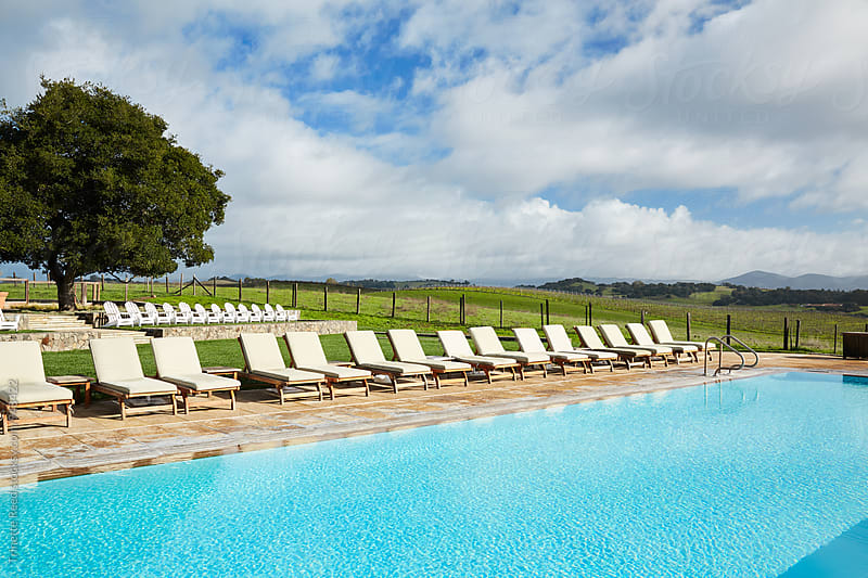 Swimming pool at luxury resort in Napa Valley, CA  by Trinette Reed for Stocksy United