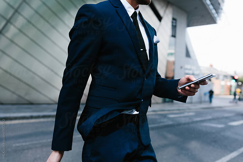 Businessman walking in the city by HEX . for Stocksy United