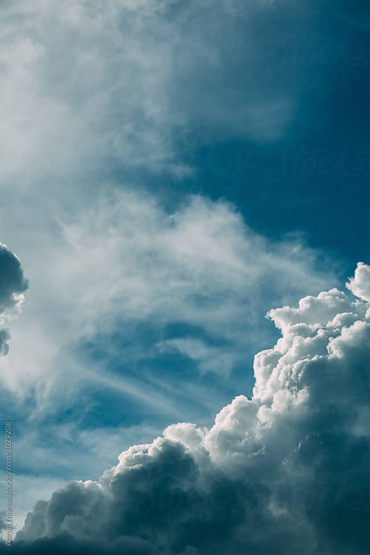 Clouds overhead by Aaron Thomas for Stocksy United
