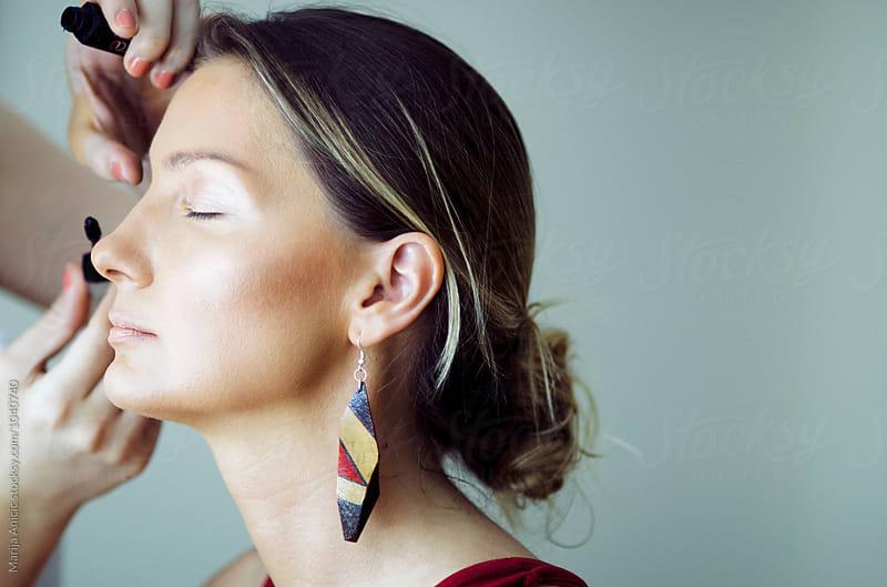 Make up process by Marija Anicic for Stocksy United