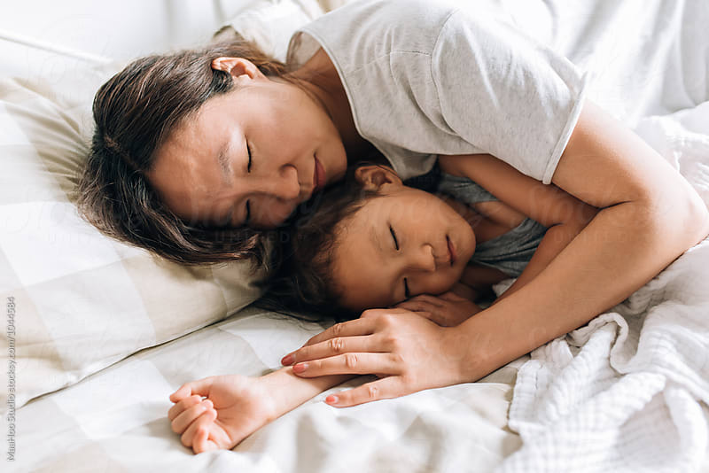 Young mother and her daughter sleeping by Maa Hoo for Stocksy United