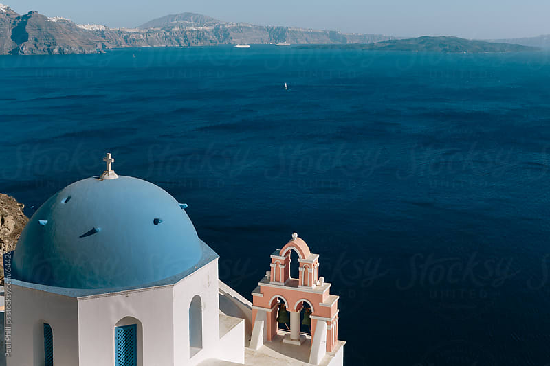 Blue domed church looking out to the caldera of Santorini by Paul Phillips for Stocksy United