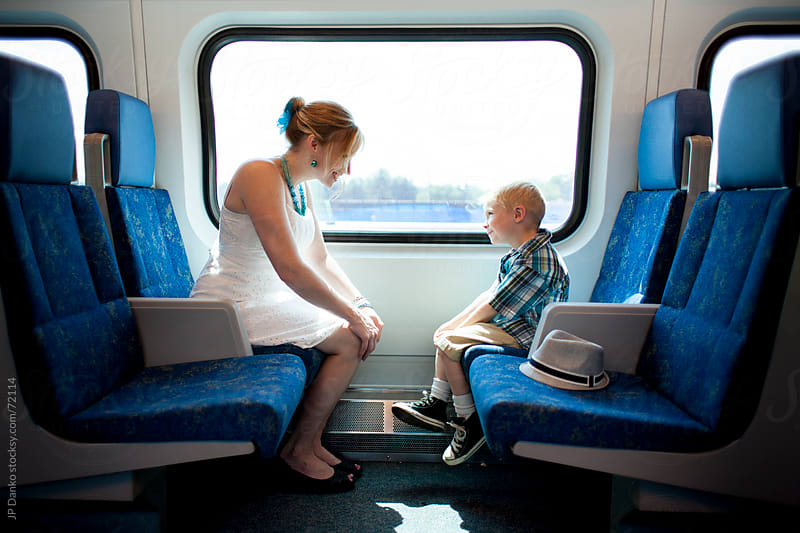 Little Boy and Mother on Train Public Transit by JP Danko for Stocksy United