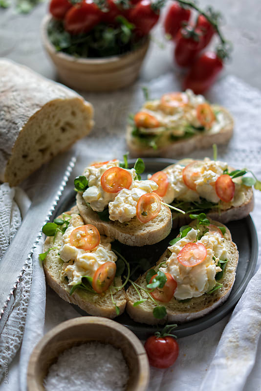 Egg mayonnaise salad sandwiches.  by Darren Muir for Stocksy United