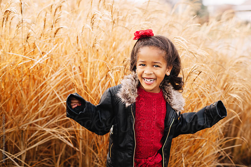 portrait of a laughing little girl by Kelly Knox for Stocksy United