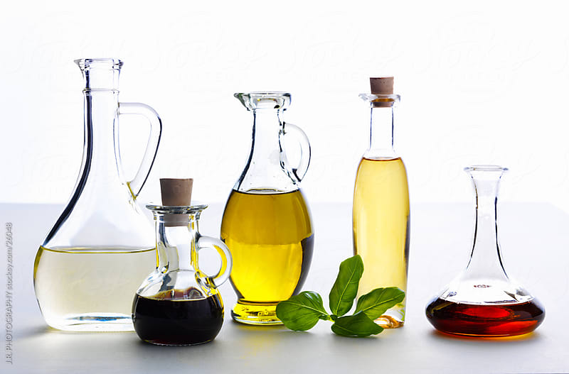 Bottles of oil and vinegar by J.R. PHOTOGRAPHY for Stocksy United