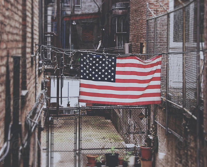 American flag in New York City by Greg Schmigel for Stocksy United