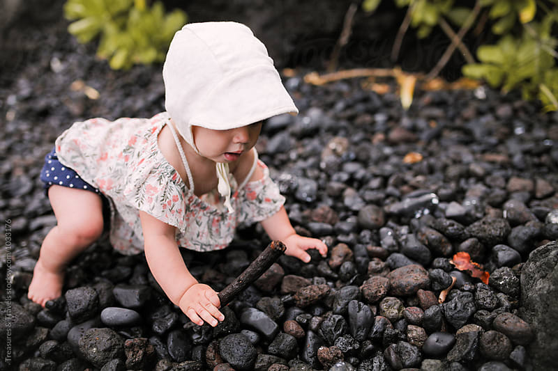 Cute Baby crawling on a rocky beach by Treasures & Travels for Stocksy United