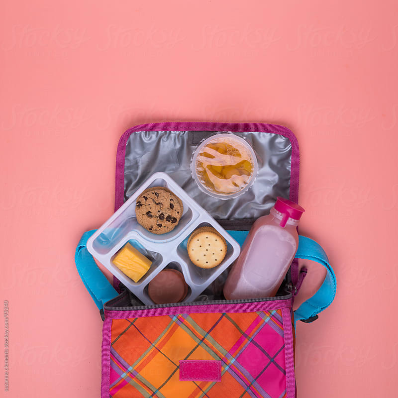 Child's Lunch Sack Spilled Open to Reveal Their Processed Meal by suzanne clements for Stocksy United