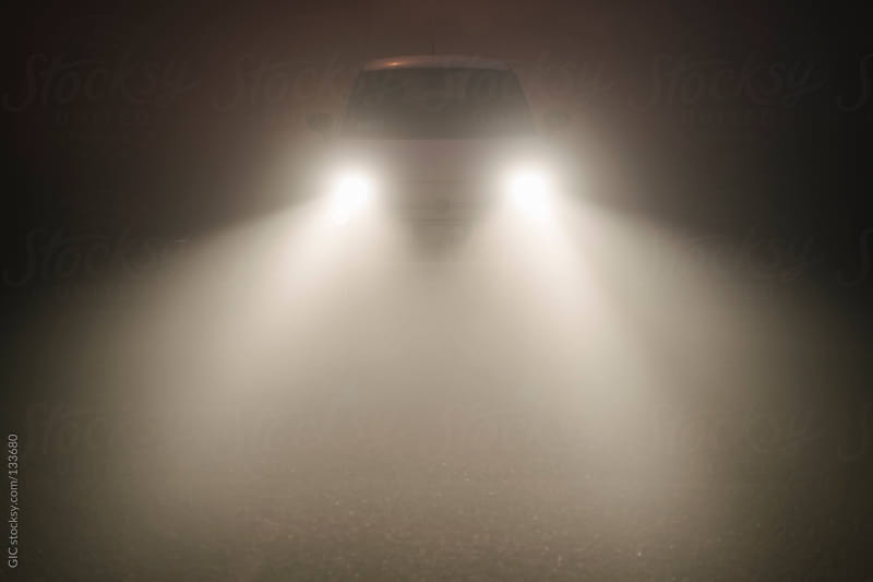 Car lights in the fog by GIC for Stocksy United