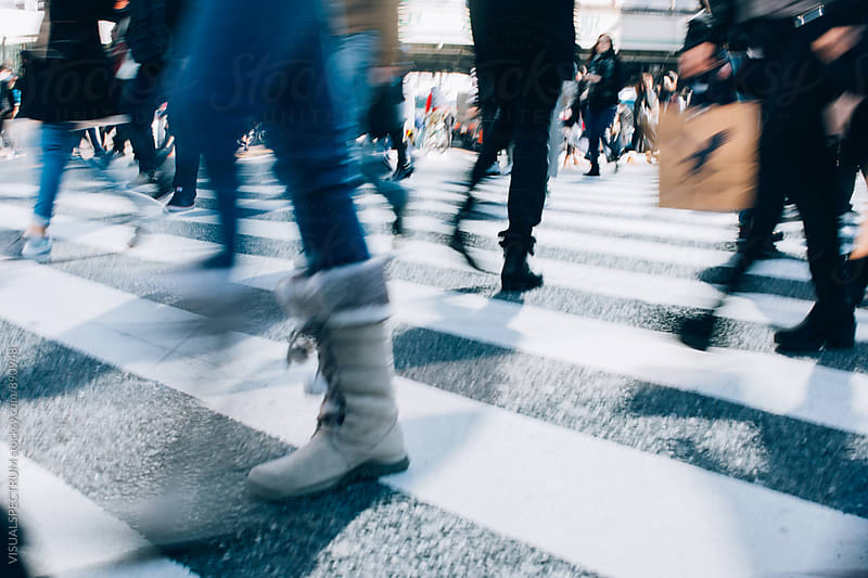 Blur of People Crossing Shibuya Crossing in Tokyo by Julien L. Balmer for Stocksy United