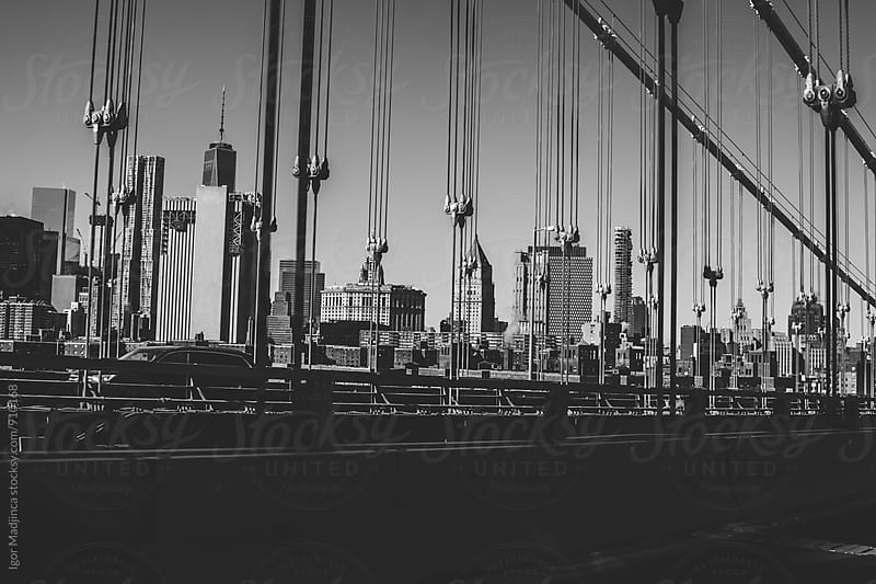New York, city, bridge, traffic by Igor Madjinca for Stocksy United