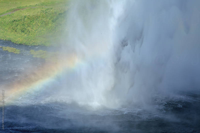 A rainbow at Seljalandsfoss Waterfall. Iceland. by John White for Stocksy United