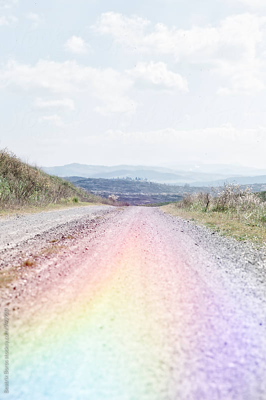 Tuscan country road with colorful light reflection by Beatrix Boros for Stocksy United