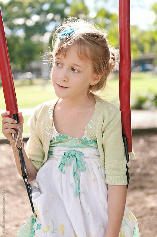 girl at the park by Gillian Vann for Stocksy United