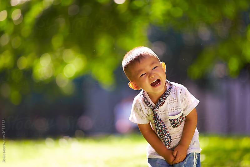 portrait of happy little asian or Chinese boy by cuiyan Liu for Stocksy United