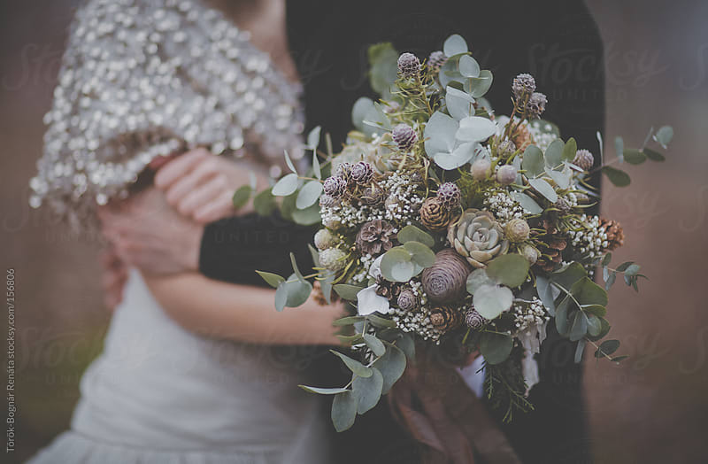 Winter wedding bouquet by Török-Bognár Renáta for Stocksy United