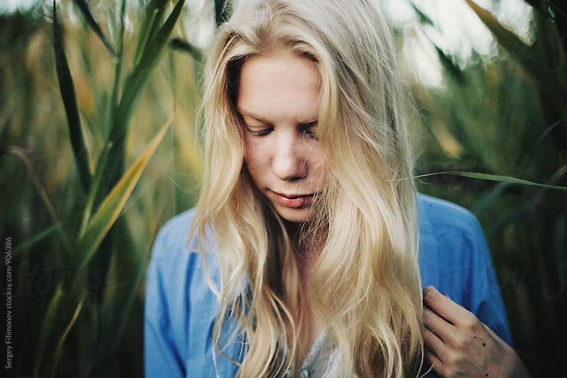Summer portrait of young blonde female by Sergey Filimonov for Stocksy United