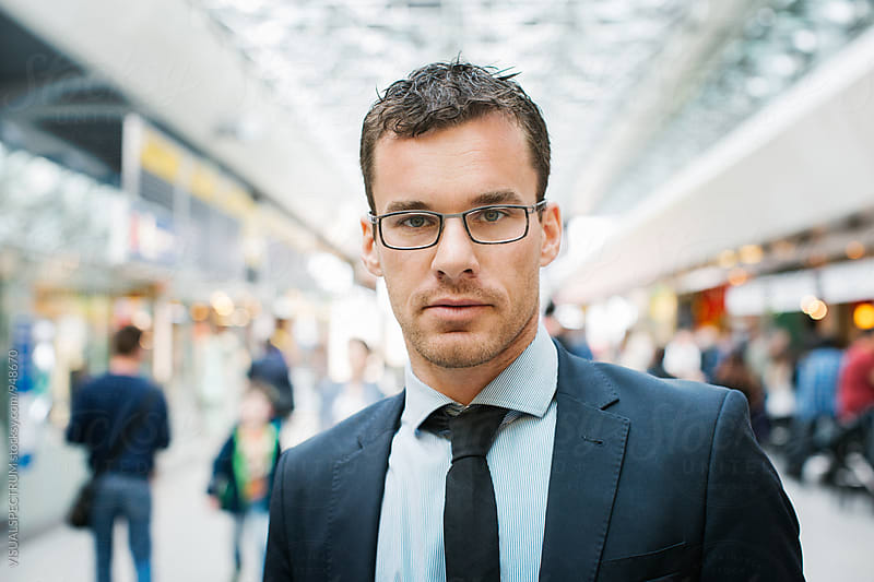 Portrait of Caucasian Businessman in Bright Airport by Julien L. Balmer for Stocksy United