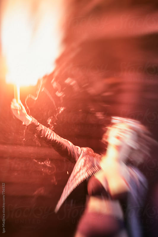 motion,a fashionable young girl holding a red torch and scream by Igor Madjinca for Stocksy United