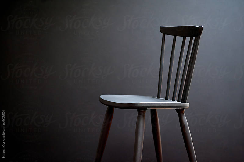 Black chair by Helene Cyr for Stocksy United