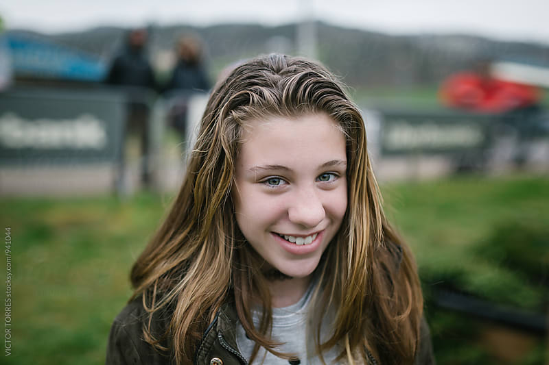 Happy Teenager with wet Hair in a Rainy Day by Victor Torres for Stocksy United