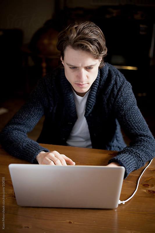 Student working on his laptop. by Koen Meershoek for Stocksy United