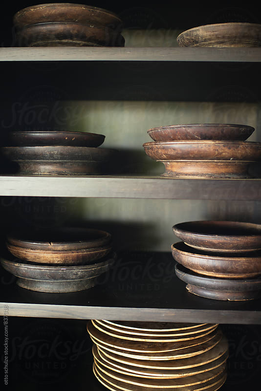 shelf of wood plates by otto schulze for Stocksy United