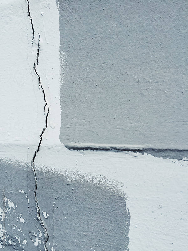 Paint covering graffiti on concrete wall, close up by Paul Edmondson for Stocksy United