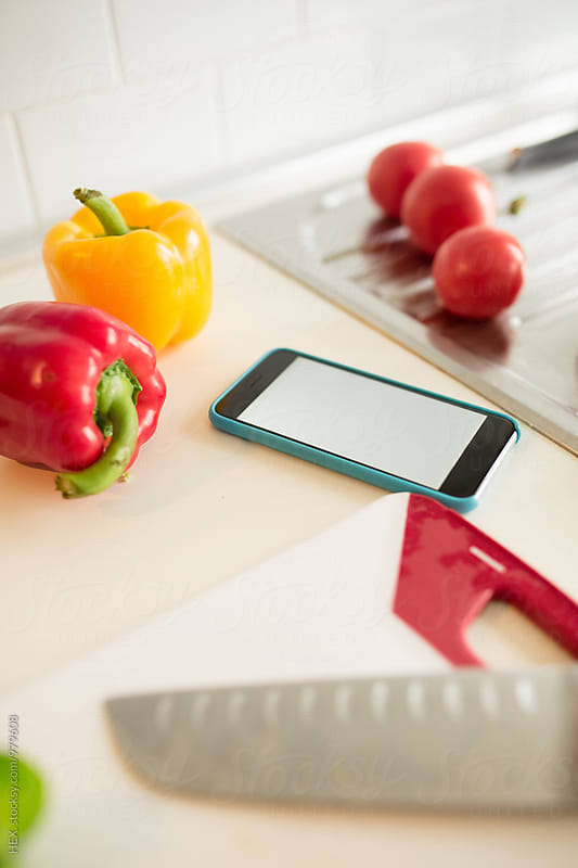 Smartphone in the Kitchen  by HEX. for Stocksy United