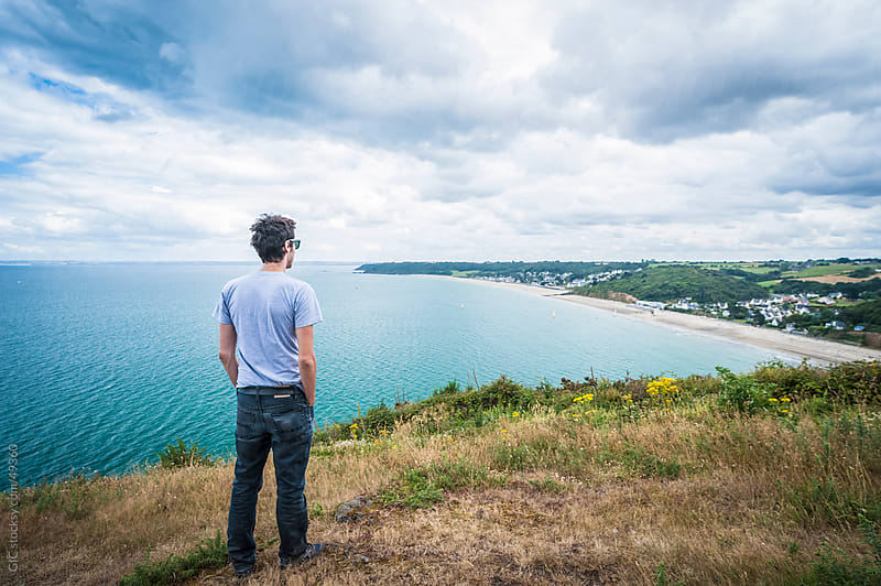 Man looking panorama in Brittany - France by GIC for Stocksy United