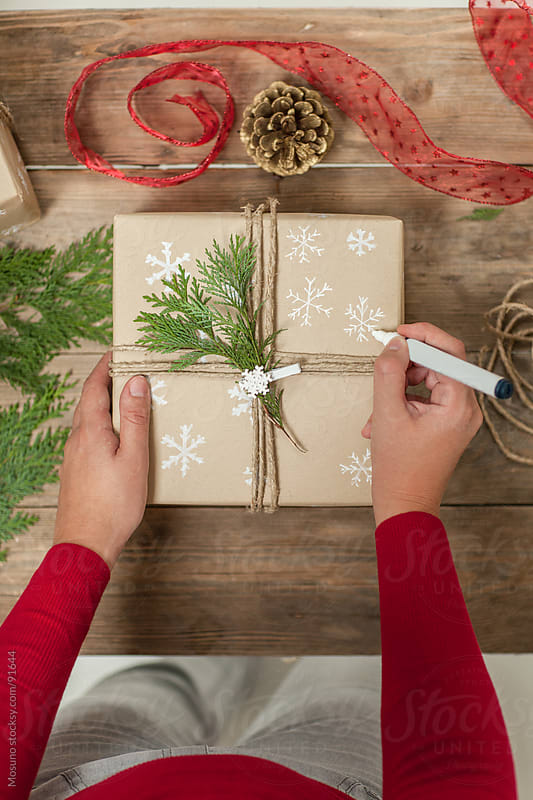 Woman Wrapping Christmas Present by Mosuno for Stocksy United