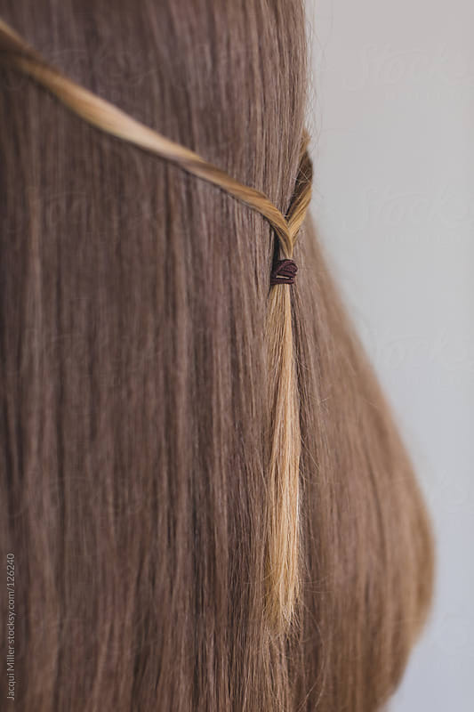 Young teenage girl with long straight brown hair by Jacqui Miller for Stocksy United