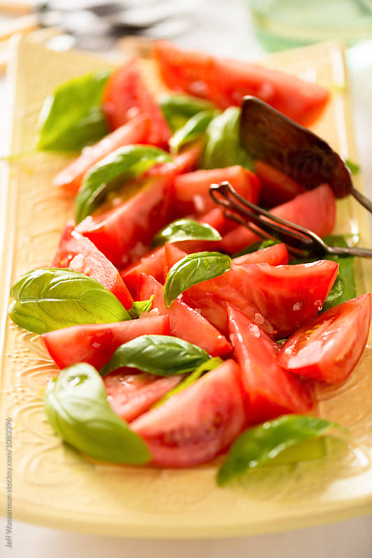 Tomato Salad with Basil  by Jeff Wasserman for Stocksy United